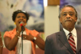 Rev. Al Sharpton listens to the praise team sing, including Brianne Bryant, left, before he...