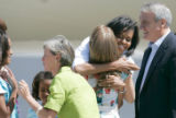 BG_0089 Michelle Obama hugs Tally Ritter, 15 center while Jeannie Ritter greets Malia, 10, and...