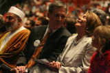 Speaker of the House Nancy Pelosi laughs with Dr. Patrick Whelan, left, president of the Catholic...