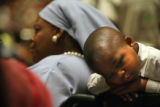 MJM619 Shariff Brown, 4, rests near his mother Shahada Mohammed during the Democratic National...