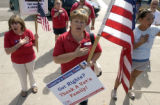 Merrilee Carlson of Hastings, Minn. sings the national anthem during a support the troops rally...