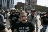 Sholom Keller, with Iraq Veterans Against the War, leads a chant near the 16th Street Mall in...