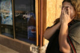 MJM038 King Soopers employee, Carmen Cavazos (cq) cries as she walk by Baskin Robbins in Aurora...