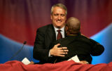 Governer Bill Ritter gives a hug to Leah Daugherty at the DNC Interfaith gathering at the Colorado...