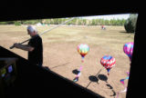 (140) Doug Grimes of Albuquerque based Discover Balloons pulls paper balloons off his trailer...