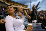 Rai Henniger's (cq) sits with his wife Heather (cq) during a Colorado Sky Sox game Saturday,...