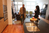 Real estate broker Lydia Lin shows a condominium to client, Greg Gold, an attorney, on the 2700...