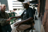 BG_0024 Claud Thompson, 57, a shoe shine man answers questions about issues sounding along the...