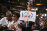 Nancy Bobo, of Iowa, sporting a hat of corn, watches the events at the 2008 Democratic National...
