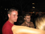 2 protesters after a clash with the police on 15th street in denver on the evening of 8/25/2008, ...