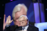 Senator Ted Kennedy talks to the delegation on stage at the Pepsi Center during the Democratic...