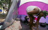 (172)  Diane Himshoot and her husband Jim Himshoot clean up inside and around their tent  Monday,...