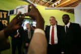 Governor Bill Ritter takes a photo with Mustafa Ali (cq) during Exhibit Darfur at Ditto Gallery on...