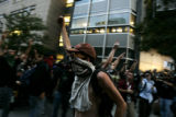Protesters march down 15th and Court Streets on Monday, August 25, 2008.  Police surrounded and...