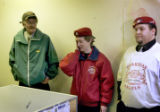 Thomas Forrest (cq), 53,left, listens to local Guardian Angels Mary Pinkas (cq), 50, middle, and...