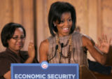 BG_0049 Michelle Obama waves to the crowd before holding a round table on Economic Security at the...