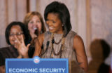 BG_0076 Michelle Obama waves to the crowd as she holds a round table on Economic Security at the...