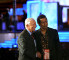 President Jimmy Carter, left, and music artist, Alejandro Escovedo, right, of Austin, Texas, pose...