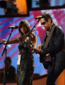 Music artist, Alejandro Escovedo, right, of Austin, Texas, performs with Fiddler Susan Voelz,...