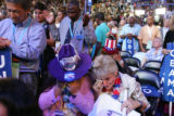Delegates Sonya Jaquez Lewis, left, and Kathy Ensz, of Greeley, embrace during the ending prayer...