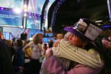Delegates Sonya Jaquez Lewis, right, embraces somebody after the closing prayer during the...