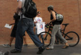 Zac Rossetto, 18, sells t-shirts on the 16th Street Prominaden in Denver, Colo. Aug. 25, 2008. He...