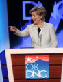 Sen. Hillary Clinton, left, D-NY,  points to the floor during a sound check at the Pepsi Center...