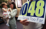 Claire Osmond (cq), 21 months, and her mother Paula Osmond (cq), shush each other at the no on...