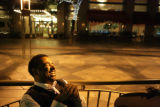 Eric Lee (cq) a delegate from Los Angeles sits along the 16th street mall with other delegates...