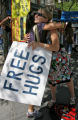 Meryl Wisner (cq), right, offers free hugs, Wednesday afternoon, August 27, 2008, on the 16th...