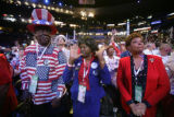 Florida delegates Rev. Preston Marshall, left, Elizabeth Collins, center, and Cynthia Chestnut,...