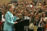 Sen. Hillary Clinton takes the stage in Korbel Ballroom at the Colorado Convention Center to...