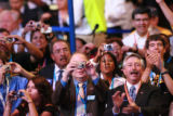 Congressman John Salazar claps  while his brother Ken Salazar speaks at the Democratic National...