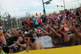 "Thousands of protesters sit and chant inside of the ""Freedom Cage"" near the site of the..."
