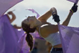 Sixteen year-old junior Sarah Knutson (cq), of Arvada practices her flag skills as part of the...