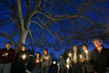 About 25 people gathered on the front lawn of Cody and Heather Dittenber's (cq) Littleton home...