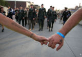 "(141) Self proclaimed ""police liasons"" hold hands to create a protective space around..."