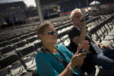 Abana Jacobs, left, and Ron Main listen to Stevie Wonder's sound check as preparations for...
