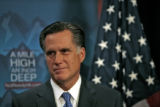 Former governor Mitt Romney, listens to U.S. Rep Lincoln Diaz-Balart,(not in photo) speak to the...