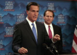 U.S. Rep Lincoln Diaz-Balart, right listens to Former governor Mitt Romney, speak to the media,...