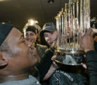 HTA179 - Chicago White Sox's Juan Uribe, left and Chris Widger, right, hold the World Series...