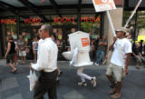 Jason Knauf of Denver donned a toilet costume and ran down the 16th Street Promenade yelling...