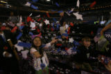 Eight-year-old Sabrina Fluentes, daughter of Penn delegate Wendy Fluentes has her own confetti...