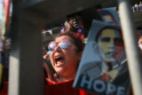 Kat Lavato, of Denver, screams at remarks made by House Speaker Nancy Pelosi at Invesco Field at...