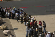 People wait in line to get into Invesco Field on the final day of the Democratic National...