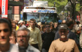 One of several Free Mall Ride buses comes to a stand still as crowds on 16th Street Mall block the...