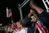 (at right) Andrea Ussery (cq) from California, cheers as Obama enters the stage at Mile High...