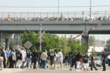Crowds exiting the lightrail below Colfax Ave at 5th St. are steered to the end of the line to get...