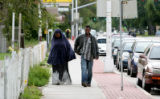 Somali Muslims arrive for mid-day prayers at the  Greeley Islamic Center on 8th Avenue Thursday...