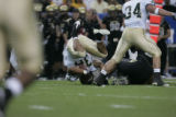 #36 Corey Nabors (cq) of Colorado is tackled during the Colorado versus Colorado State college...